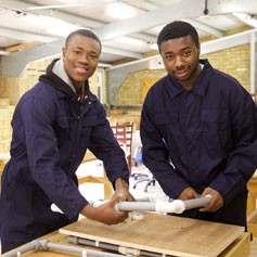 Two young men in a workshop from a charity in Crystal Palace that received funding from the John Lewis Foundation